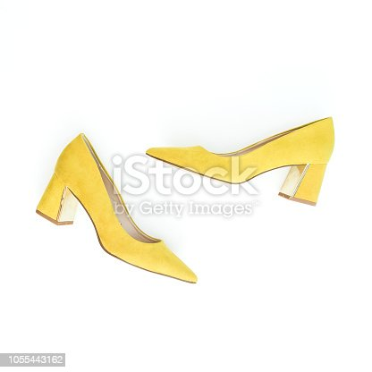 Women fashion background with yellow shoes on white. Flat lay, top view.