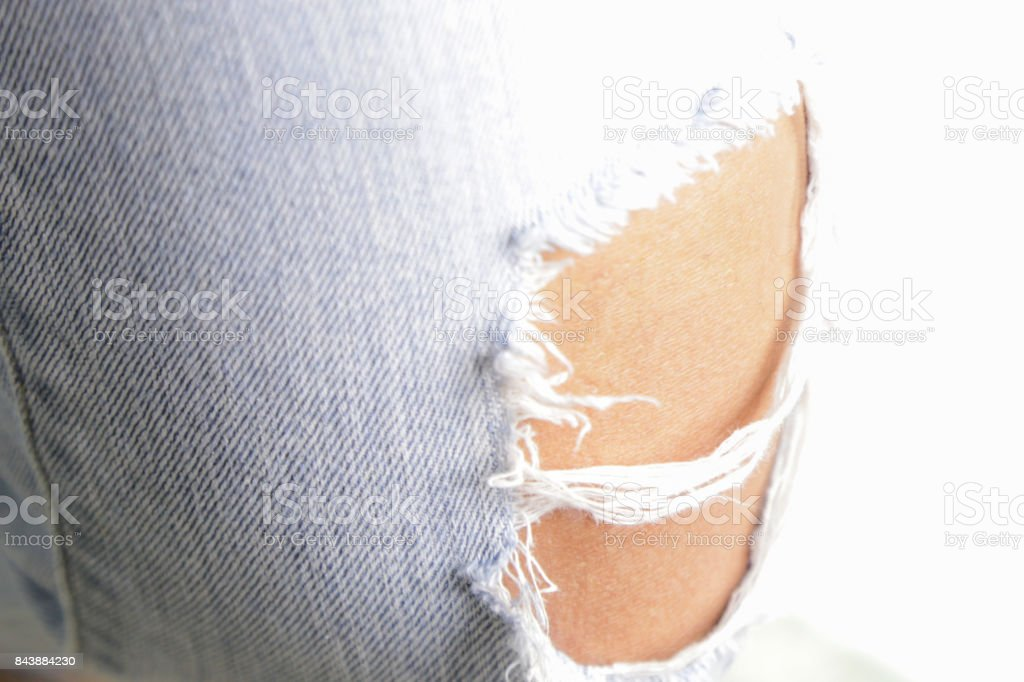 women fashionable ripped Jeans. torn blue jeans and women stock photo