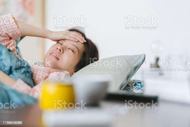 Women feeling sick and sleeping on sofa at home picture id1158649086?b=1&k=6&m=1158649086&s=612x612&h=s9n mbz1nnldme 2yxdxbawvf6c xnukghrl1pb wuy=