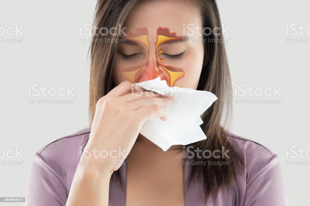 Women feeling unwell and sinus on gray background stock photo