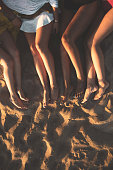 Women feet on a sandy beach