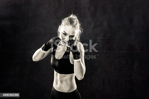 istock Women Fighter in a Stand Off In Black and White 499086086