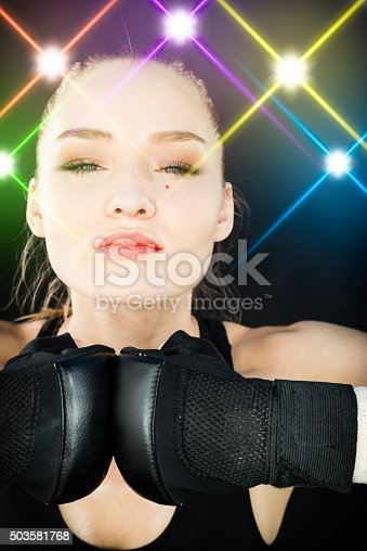 istock Women Fighter Posing With Arena Lighting Flares in the Background 503581768