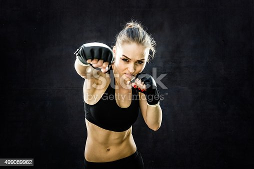 istock Women Fighter Punching Close Up 499089962