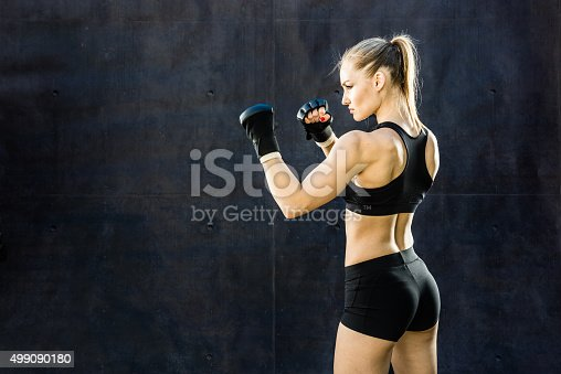 istock Women Fighter Punching Close Up 499090180