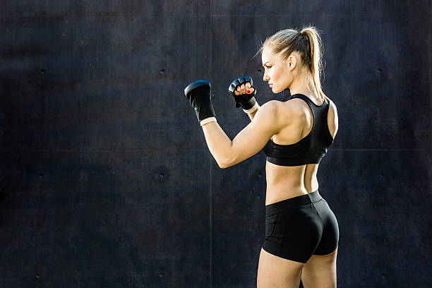 Women Fighter Punching Close Up stock photo