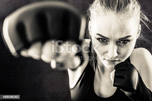 istock Women Fighter Punching In Black and White 499086362