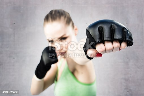 istock Women Fighter Punching White Background 498982486