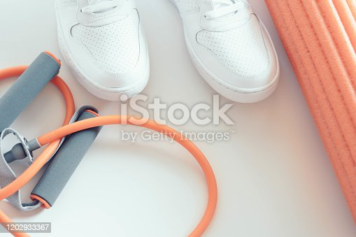 533343620 istock photo Women fitness training accessories. You can do ti light box, white sport shoes and training accessories on white backgorund. 1202933367