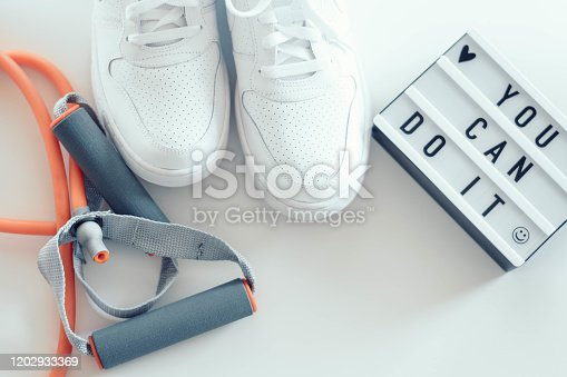 533343620 istock photo Women fitness training accessories. You can do ti light box, white sport shoes and training accessories on white backgorund. 1202933369