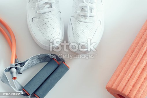 533343620 istock photo Women fitness training accessories. You can do ti light box, white sport shoes and training accessories on white backgorund. 1202933385