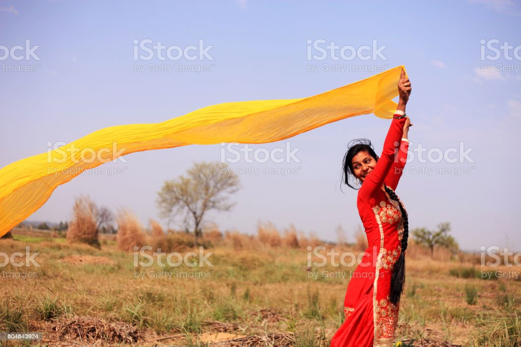 Women flying colorful clothes in nature stock photo