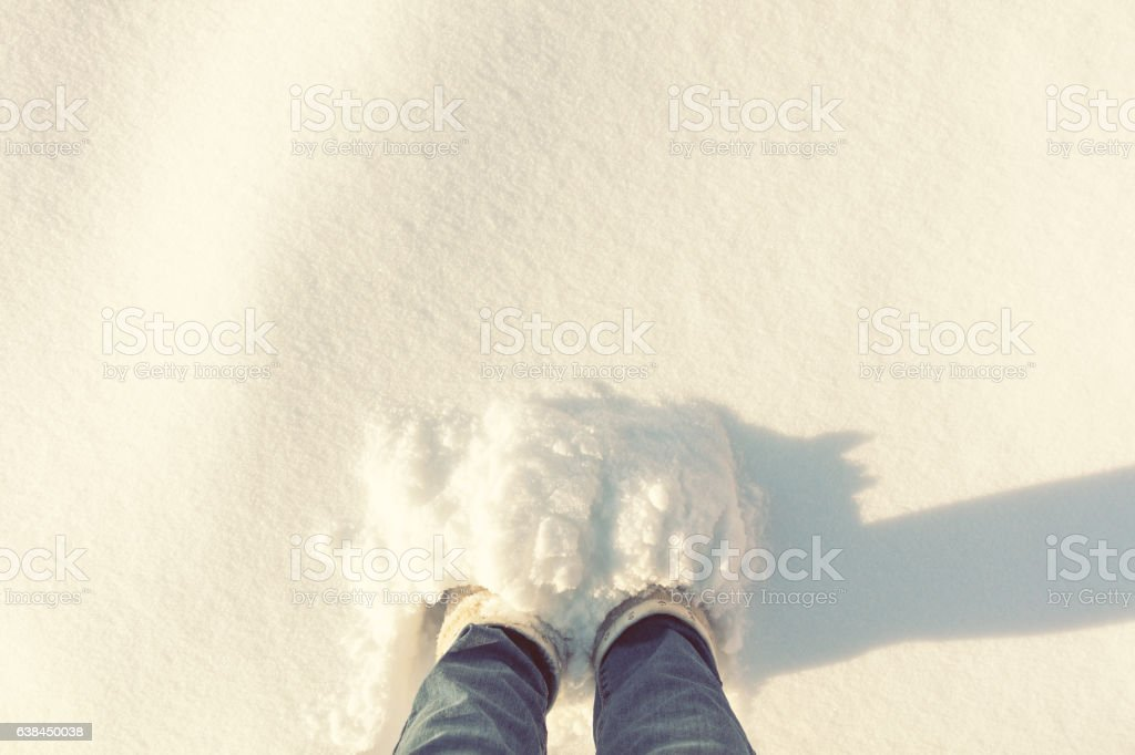 Women foots in a large depth of snow stock photo
