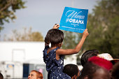 Las Vegas, Nevada - November 1st, 2012: a young African American Girl holds up a sign at a political rally for President Barack Obama atop her Father's shoulders. This was the President's last rally in Nevada before his re-election bid in 2012.