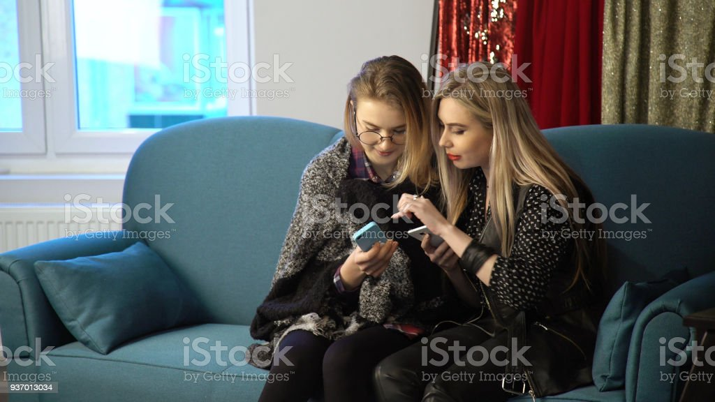 women friends bff phone social network addiction stock photo