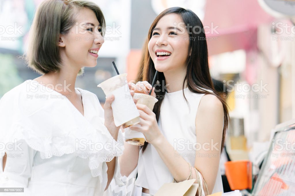 Women friends out for shopping in Bangkok city streets stock photo
