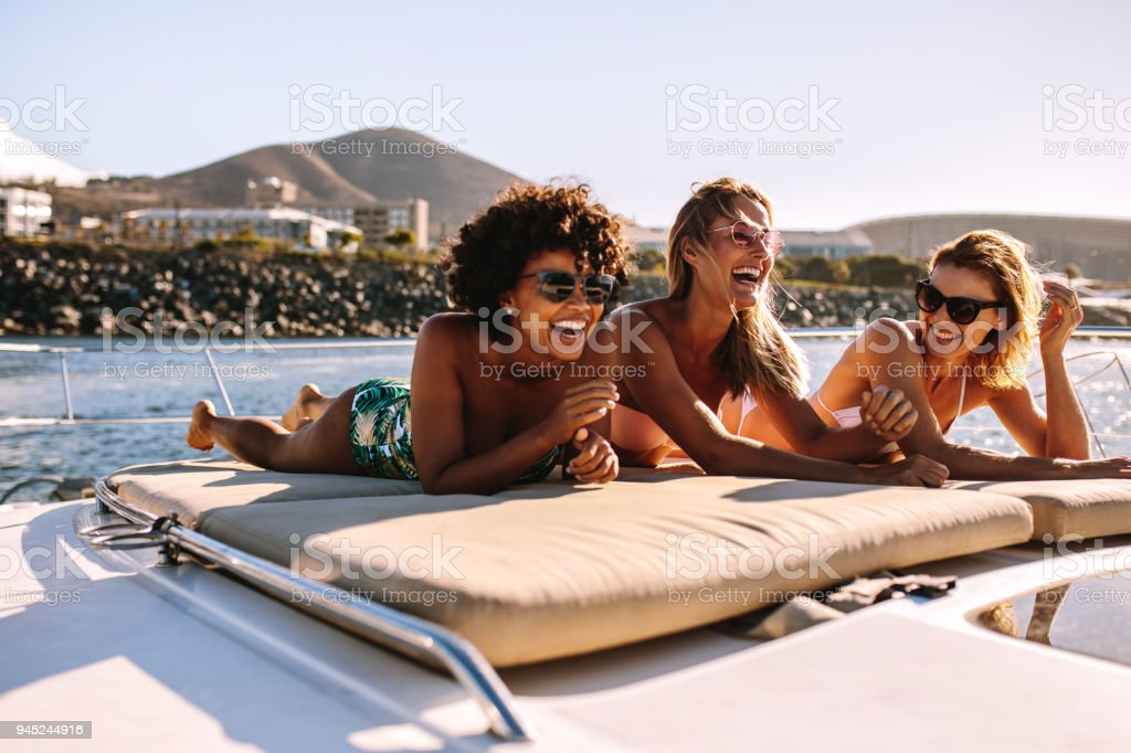 Women Friends Relaxing On A Private Yacht Deck Stock Photo ...