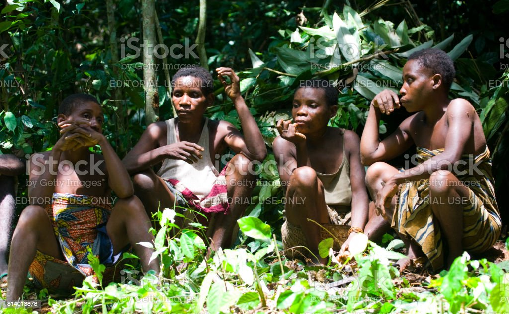 Women from a tribe of pygmies sit in the forest. Dzanga-Sangha Forest Reserve, Central African Republic, November 2, 2008 stock photo