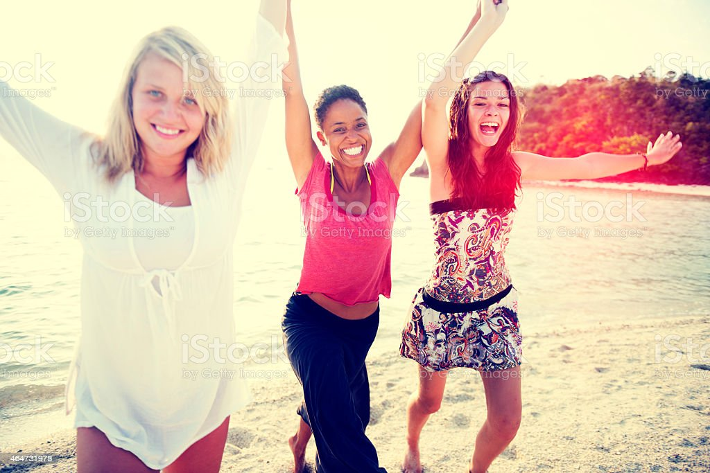 Women Fun Beach Girls Power Celebration Concept stock photo