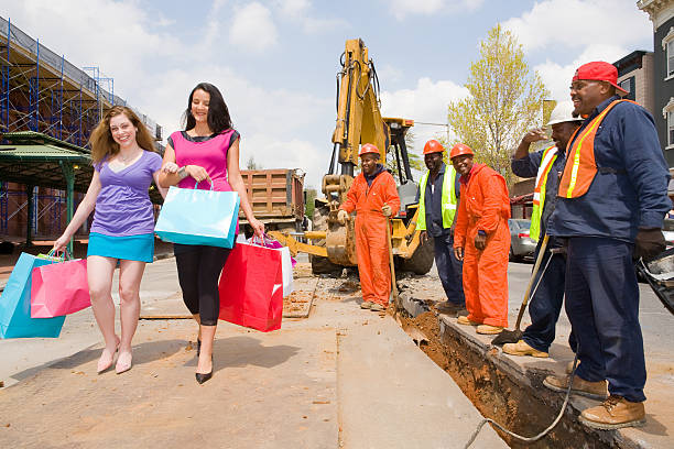 Women get attention at a construction site stock photo