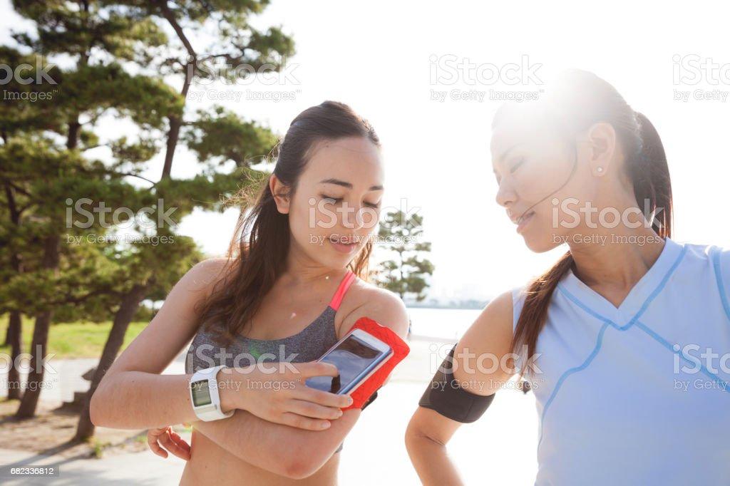 Women getting fit taking run afterwork in Tokyo zbiór zdjęć royalty-free