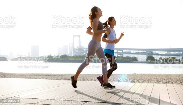 Women getting fit taking run afterwork in tokyo picture id682336824?b=1&k=6&m=682336824&s=612x612&h=ntplpmpzgshn03fz8llrx pnb8gjhwqrlcdd awscfe=