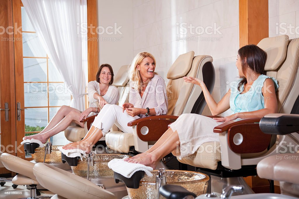 Women getting pedicure stock photo