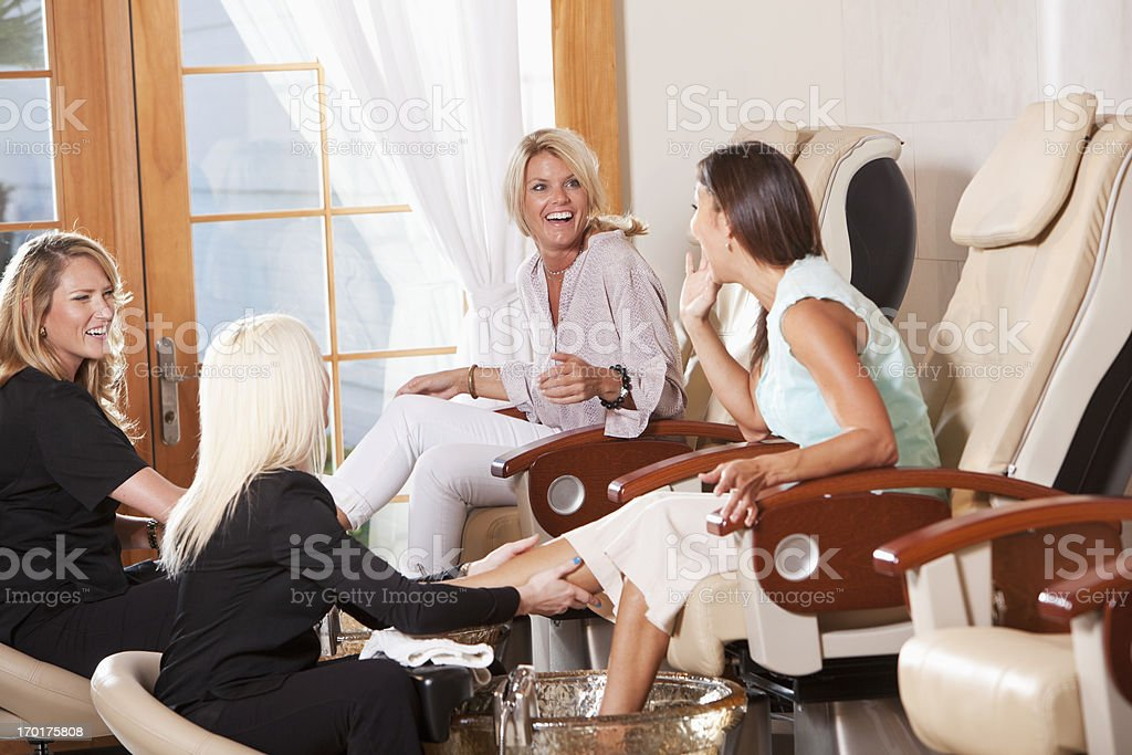 Women getting pedicures royalty-free stock photo
