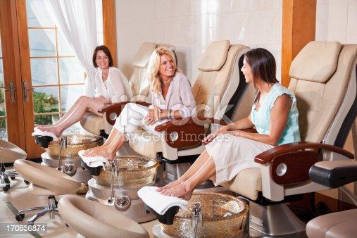 istock Women getting pedicures 170536874