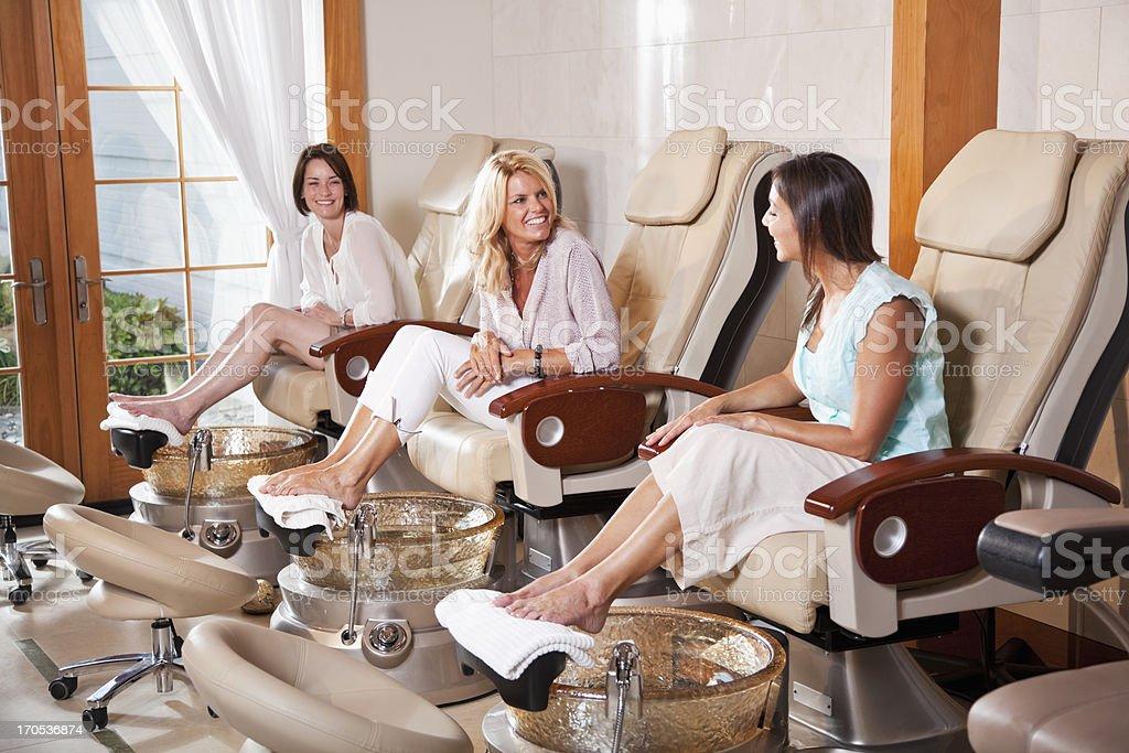 Women getting pedicures stock photo