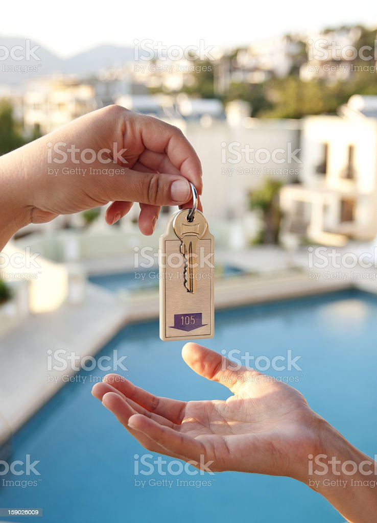women gives hotel key stock photo