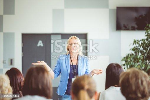933450738 istock photo Women giving speech during seminar 933450964