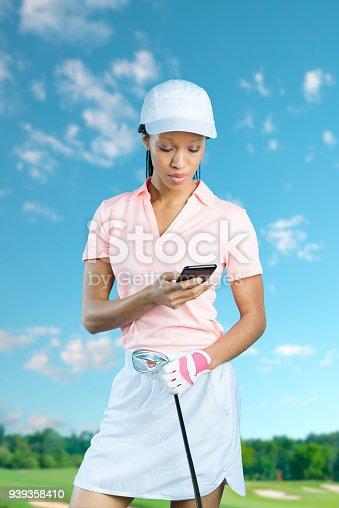 952196272 istock photo Women Golfer Checking Her Phone 939358410