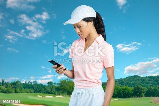 952196272 istock photo Women Golfer Checking Her Phone 939358454