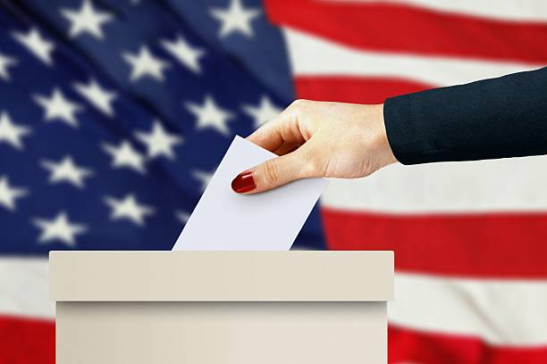 women hand casting a vote stock photo