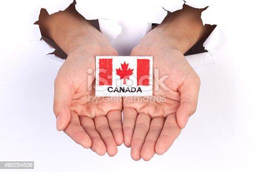 istock Women Hand Holding Canada Flag 495254536