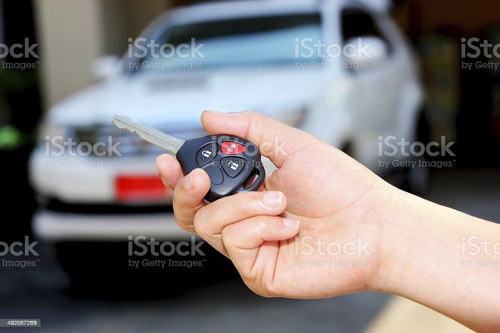 Women hand holding car key stock photo