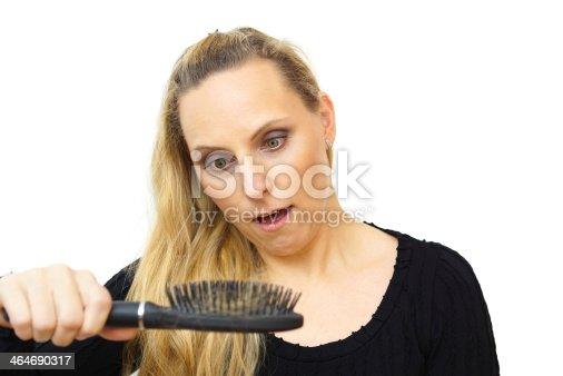 istock women hand holding loss hair comb 464690317