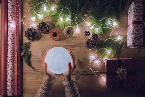 Women hand holding moon Flat lay Christmas concept.