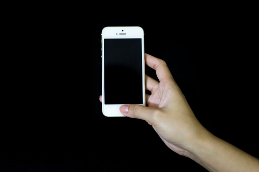 Women hand holding the iPhone 5