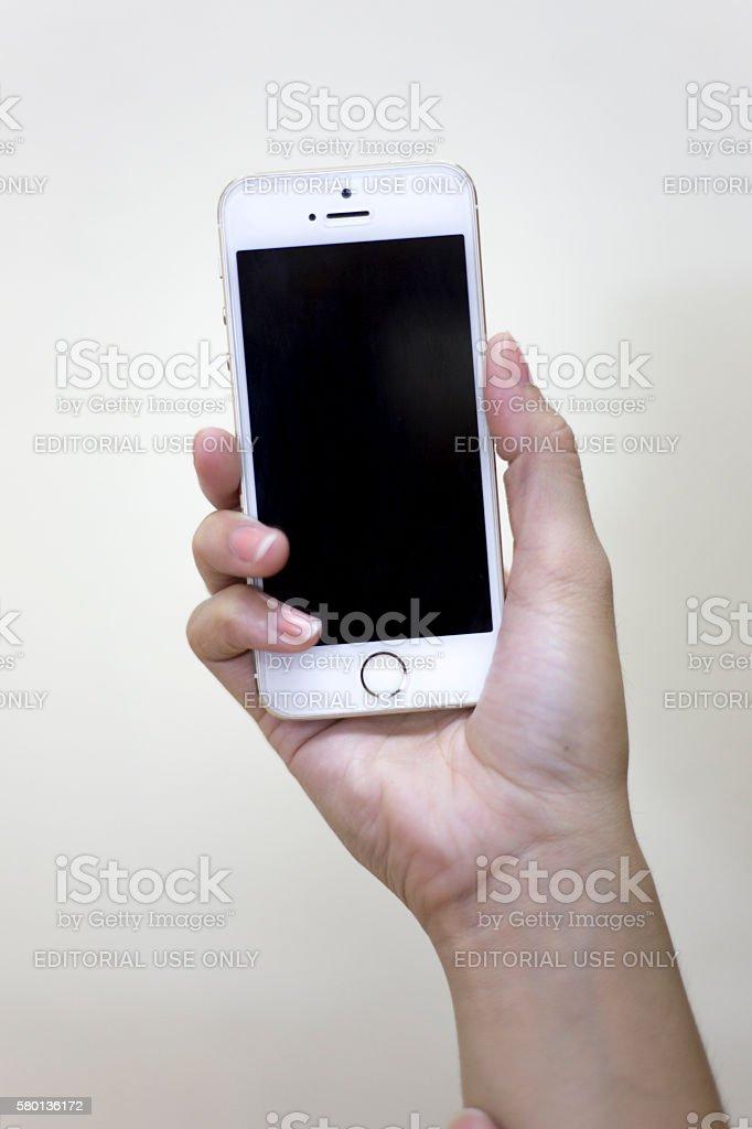 Women hand holding the iPhone 5 stock photo