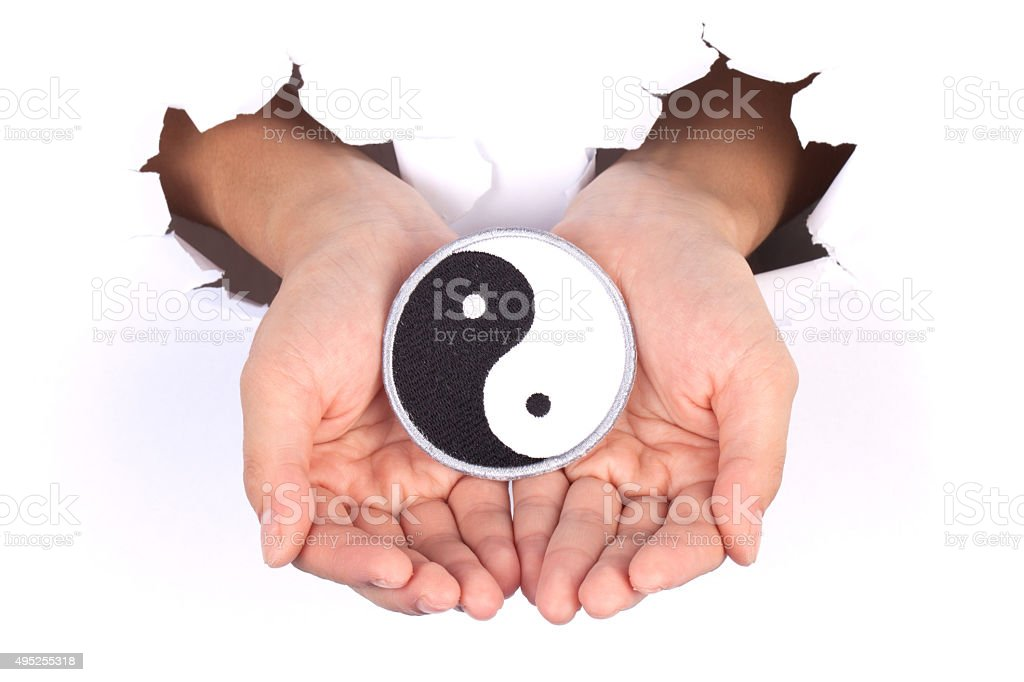 Women Hand Holding Yin Yang Flag stock photo