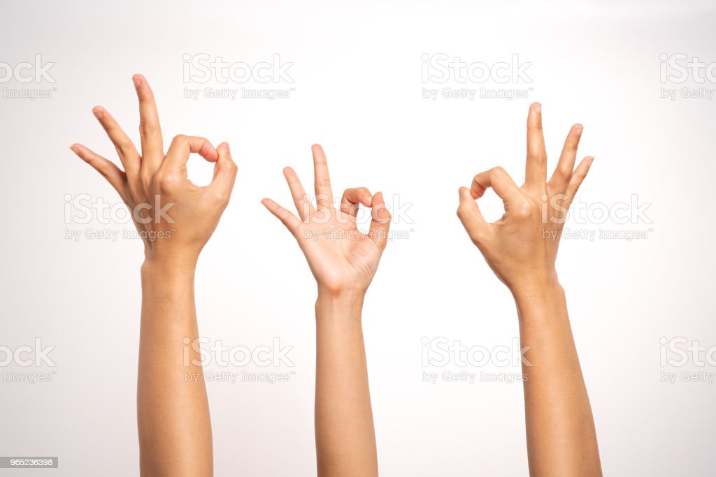 women hand OK sign gesturing on white background in three action royalty-free stock photo