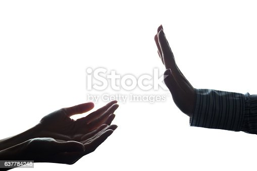 istock Women hand stretched with alms across from the refusal 637784248