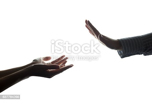 istock Women hand stretched with alms across from the refusal 637784266