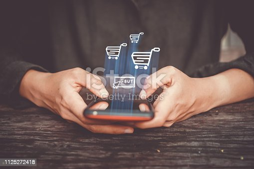istock Women hand using smartphone do online selling for people shopping online in black friday with chat box, cart, dollar icons pop up. Social media maketing concept. 1125272418