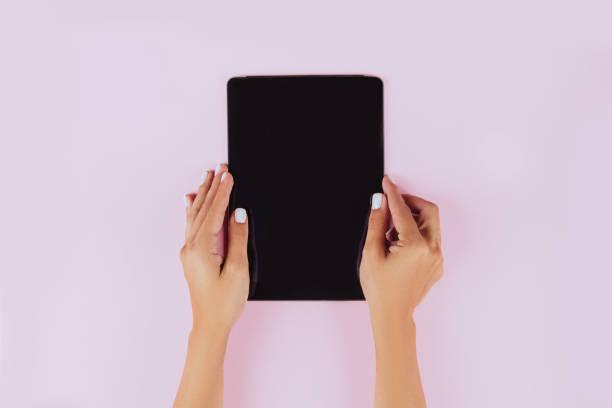 Women hands holding tablet computer stock photo