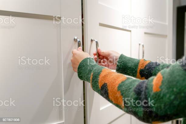 Women hands open the cupboardcabinet door white wooden door picture id927801936?b=1&k=6&m=927801936&s=612x612&h=8b6tffcd3t11j oq rigkcl6 xhu6n3uovhs4d3p5yo=