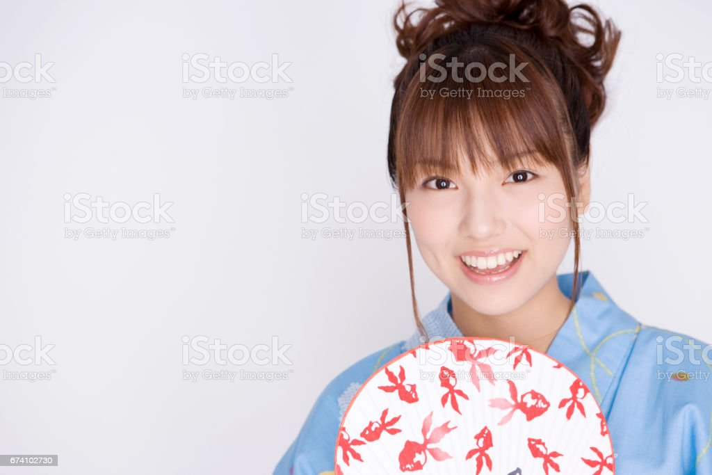 Women have a fan wearing a yukata royalty-free stock photo