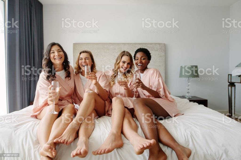 Women having a bachelorette party at hotel room stock photo